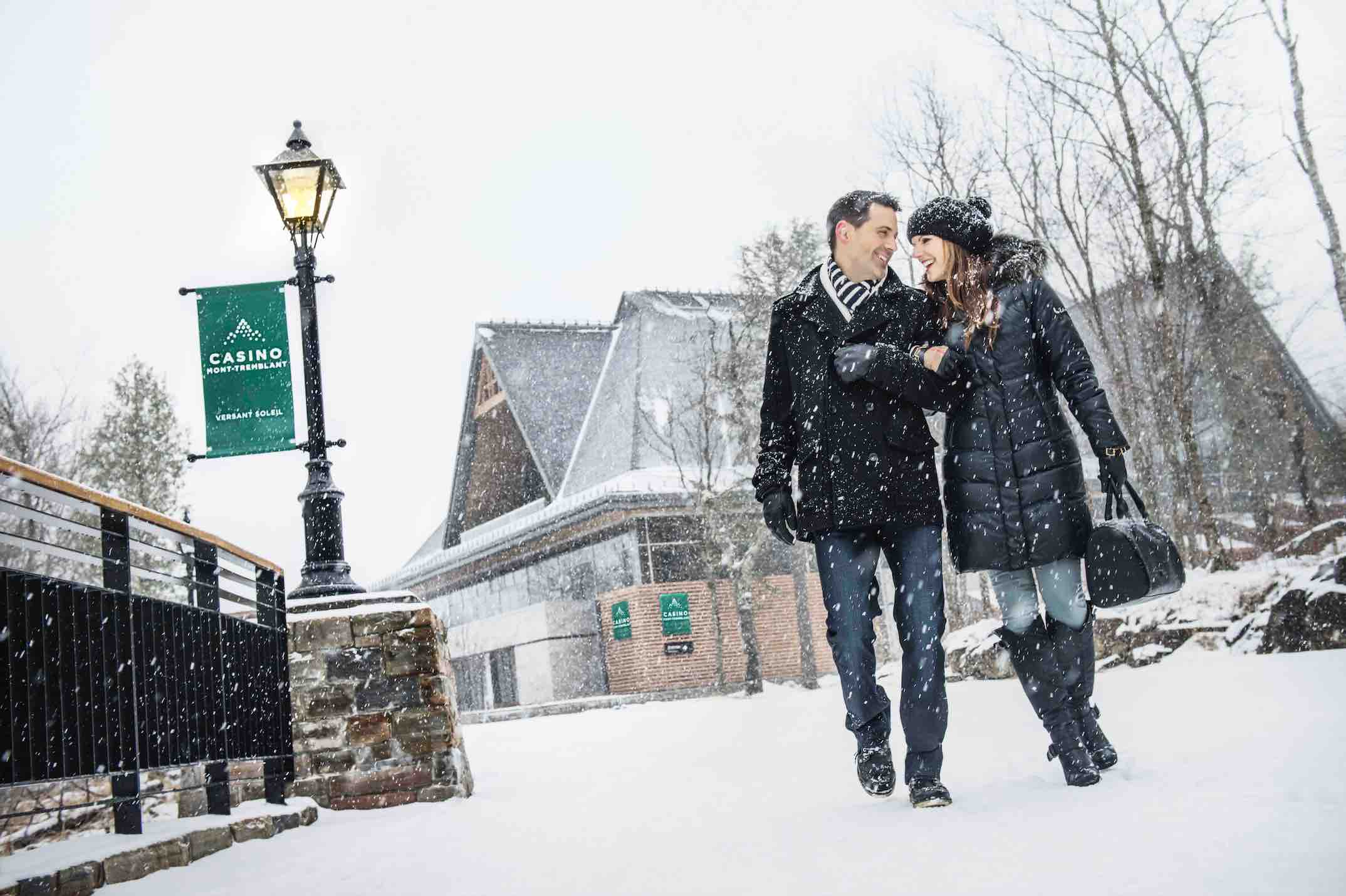 Mountain Casino with couple walking in the snow