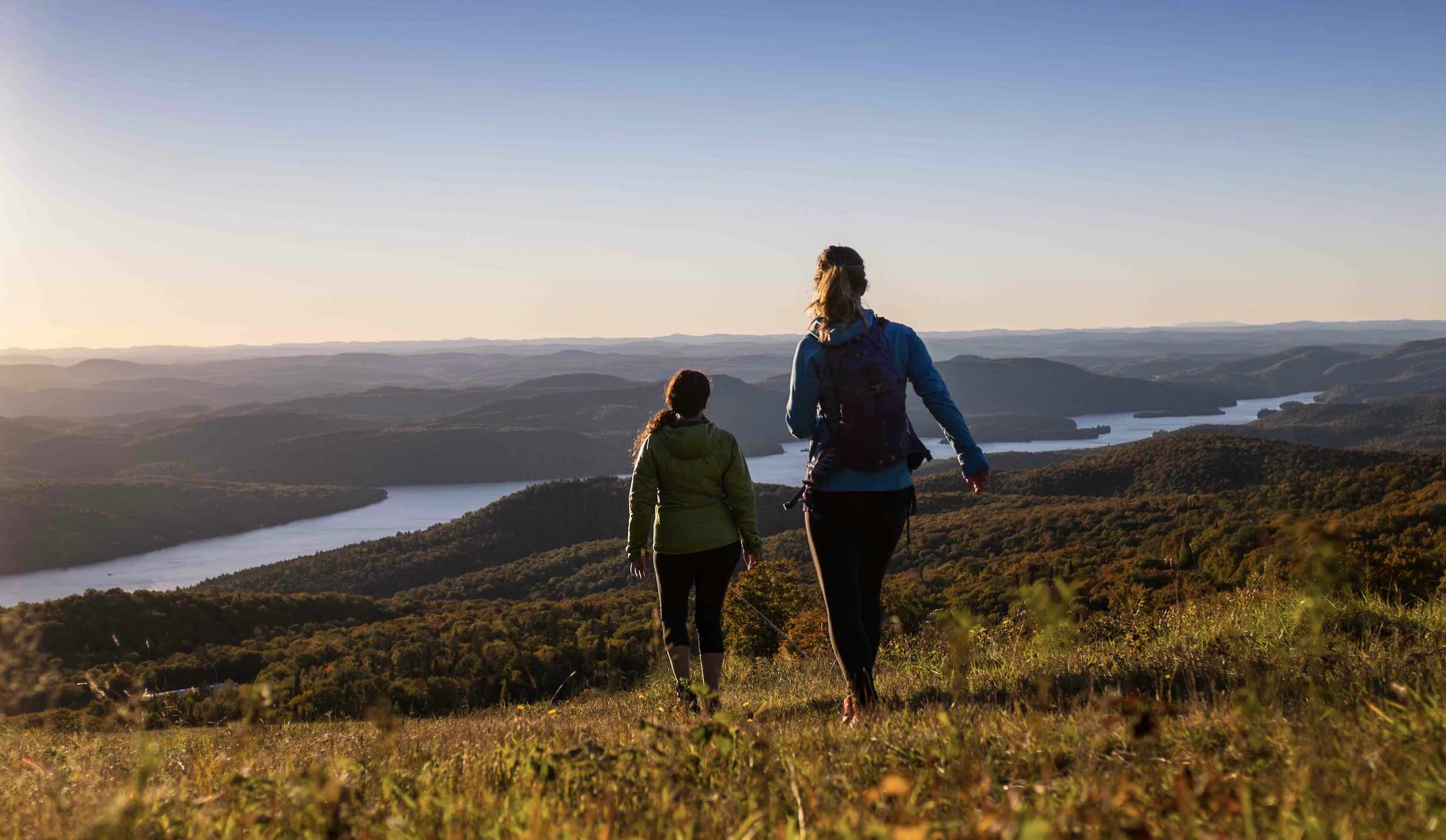 Things to do in Mont-Tremblant in summer include hiking, with 2 women looking over hills
