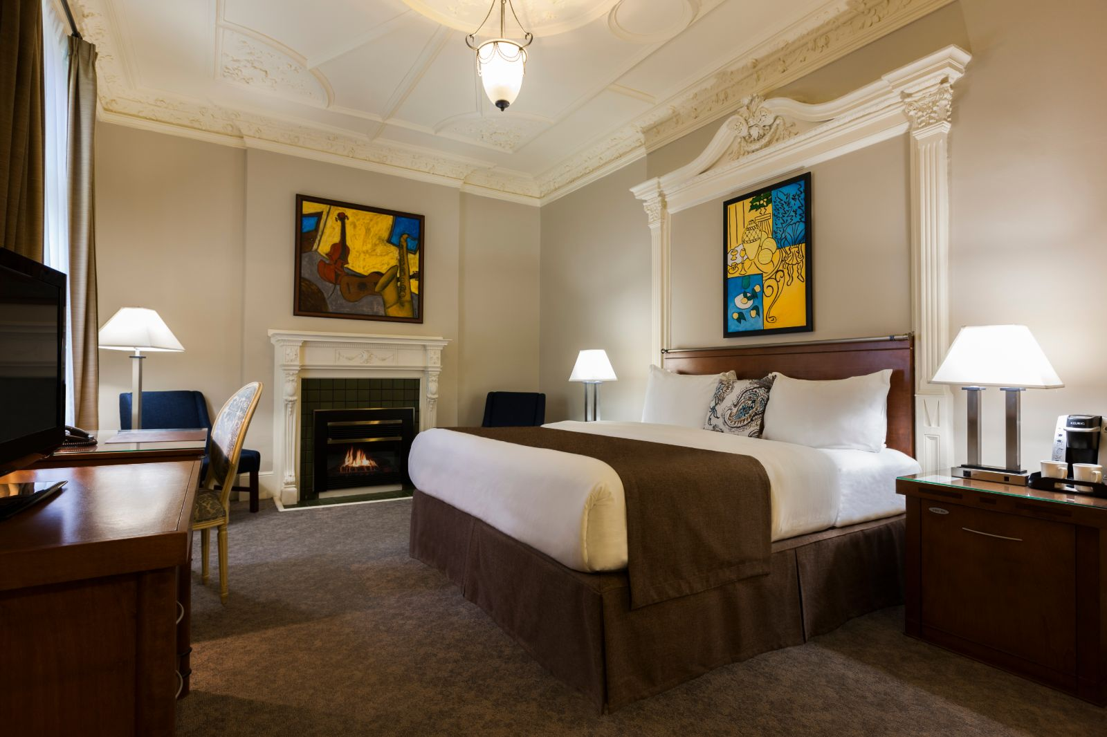 Château Versailles Fireplace Suite in luxury boutique hotels in montreal king bedrooms