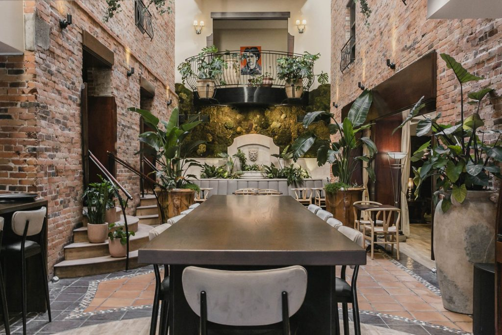 Hotel Nelligan- Atrium with seating and plants