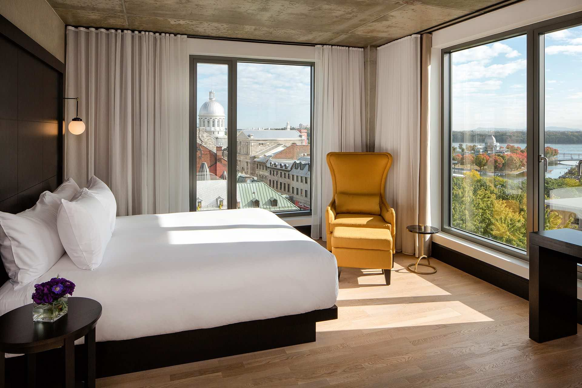 Hotel William Gray bedroom of boutique hotels in Montreal view over St Lawrence and city