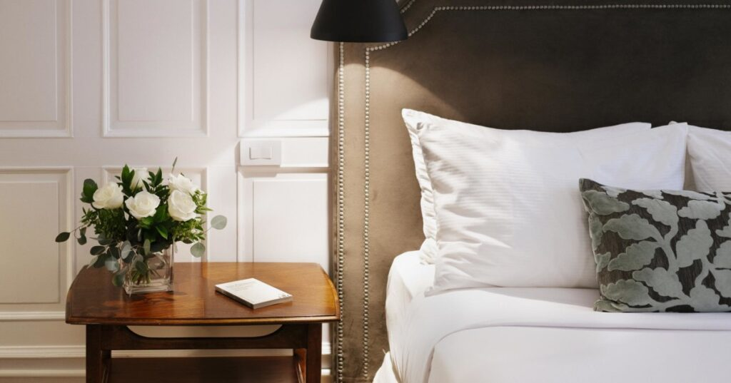 Hotel Nomad boutique hotels in Quebec City bed and side table